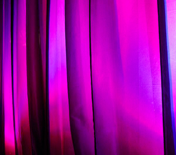 Purple drapes with normal colored lights
