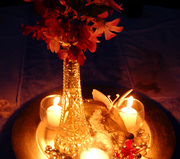A candle and flower centerpiece arrangement